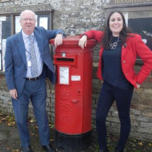 Cllr Ian Bates and Amanda Orchard standing by postbox in Houghton & Wyton