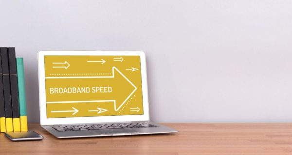Laptop with arrows pointing to the right and words on screen that say 'broadband speed'