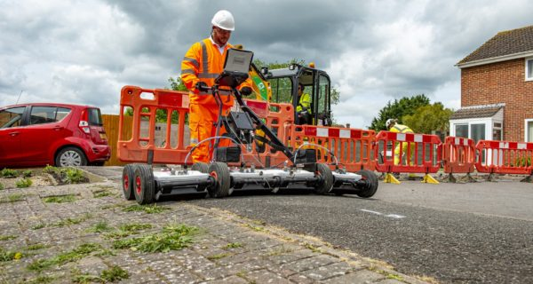 Openreach engineer using ground penetrating radar to help lay fibre cable