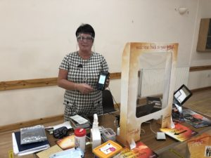 Slimming World consultant Dawn with her hand-held payment device